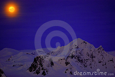 Moon on the dark blue sky of Antarctica