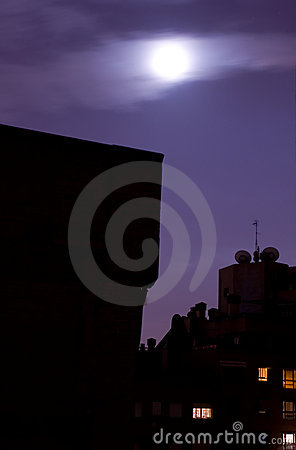 Moon over city skyline