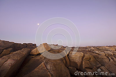 Moon over ocean and rocks