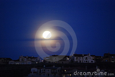 Moon over roof tops