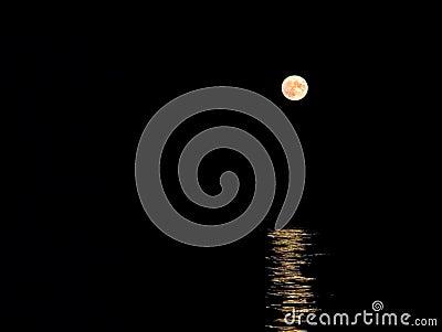 Moon Rising Above Sea