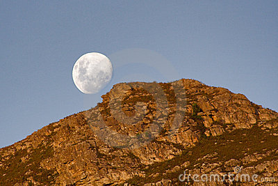 Moon rising over mountain