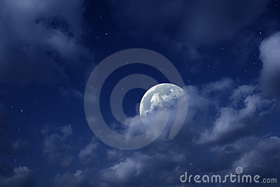 Moon and stars in cloudy sky