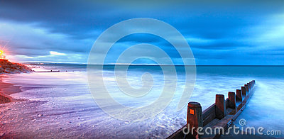 Moonlight lit beach landscape Stock Photo