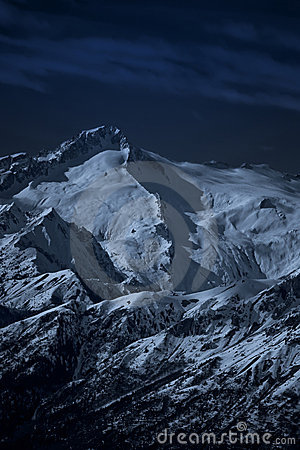 Moonlit high mountain landscape at night