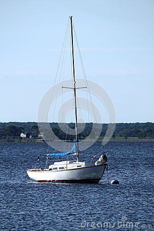 Moored white sailboat