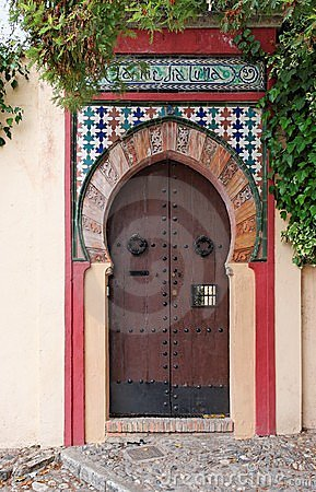 Moorish style door of a house in Granada, Spain