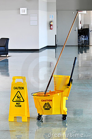 mop and bucket with caution sign royalty free stock