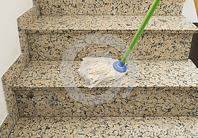Cleaning the stairs marble with mop