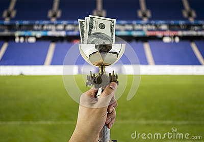 More dollars more titles with the background of a stadium