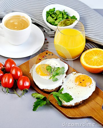 Free Morning Coffee White Cup Beverage Orange Juice Sandwich With Tasty Fried Egg Royalty Free Stock Photos - 113179878