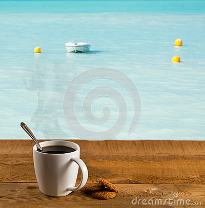 Morning cup of coffee by warm caribbean sea
