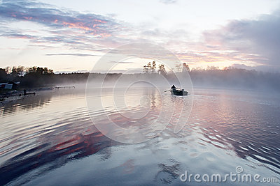 Morning fog boat lake