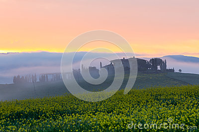 Morning fog view on farmhouse in Tuscany, Italy