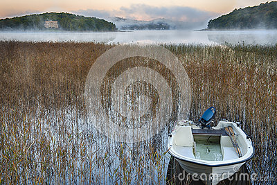 Rowboat in morning mist