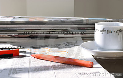 Morning newspapers with coffee