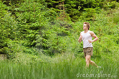 Morning run: Young man jogging in nature