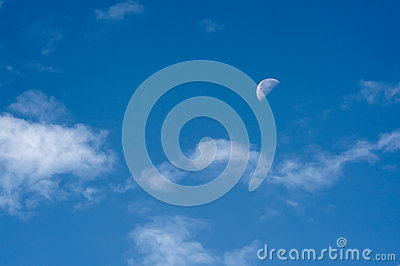 Morning sky with the half moon and clouds
