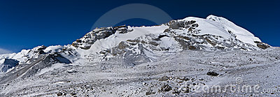Morning snow covered mountains under blue sky