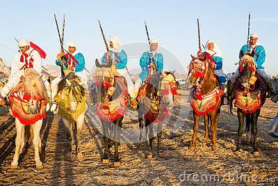 Moroccan horse riders during fantasia festival Editorial Stock Image