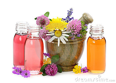 Mortar with fresh flowers and essential oil