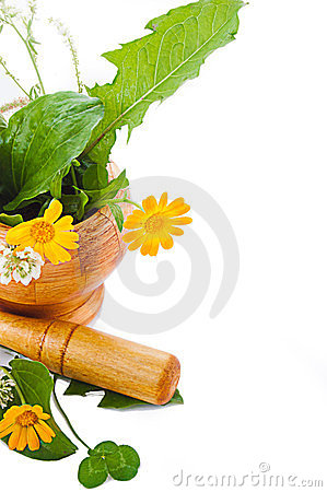 Mortar with herbs and marigolds