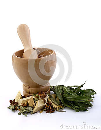Mortar with pestle and herbs