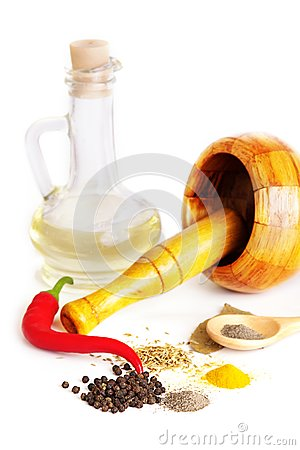 Mortar with pestle, variety of spices and oil