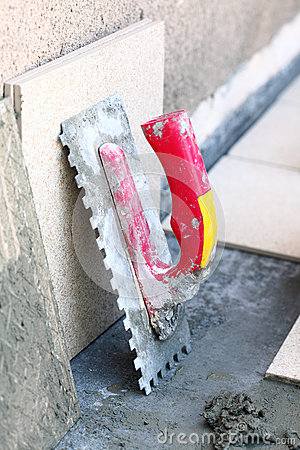 Mortar on wall construction notched trowel