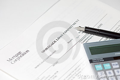 Mortgage document, pen and calculator