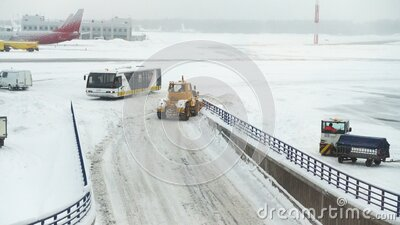 Snow blowers bulldozers graders working at the airport runway stock footage