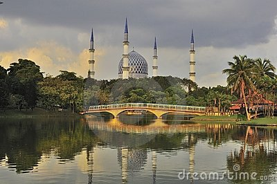 Mosque minaret and dome with reflection