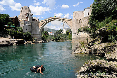 Mostar - the Old Bridge (Stari Most) with a boy Editorial Stock Photo