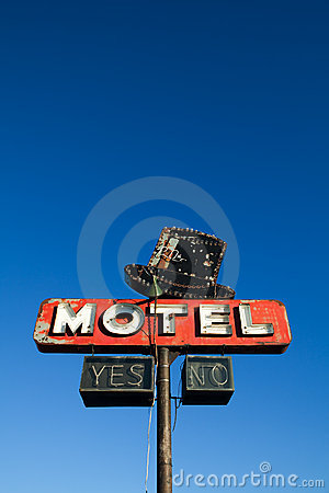 Motel sign against blue sky