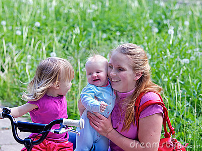Mother and 2 daughters in Park