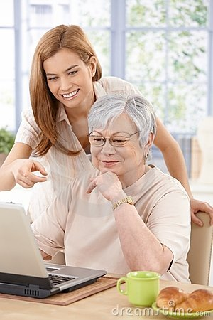 Mother and adult daughter having fun smiling