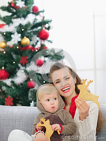 Free Mother And Baby Eating Christmas Cookies Royalty Free Stock Photos - 26742428