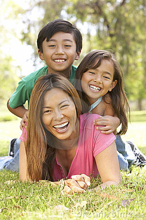 Free Mother And Children Enjoying Day In Park Royalty Free Stock Photos - 12405298