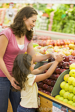 Free Mother And Daughter In Produce Section Stock Photography - 5093432