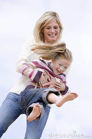 Free Mother And Daughter Playing On Beach Smiling Royalty Free Stock Photo - 5937565