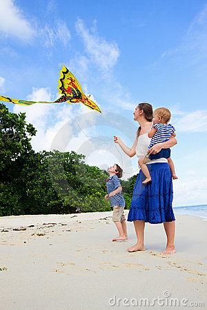 Free Mother And Her Two Kids Flying Kite Stock Image - 15799971