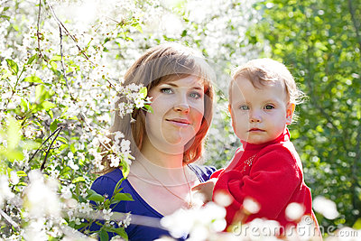 Mother and baby  in blossoming garden