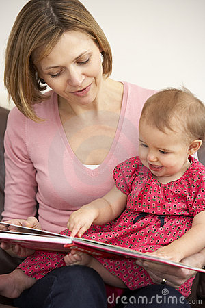 Mother And Baby Daughter Reading Book