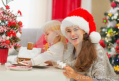 Mother and baby enjoying Christmas cookies