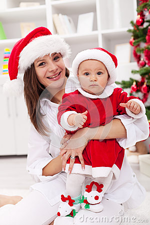 Mother and baby girl celebrating christmas