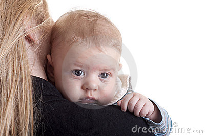 Mother with baby on her shoulder