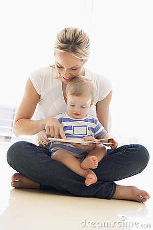 Mother and baby indoors reading book