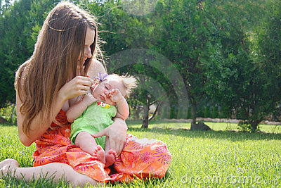 Mother and baby on natural background