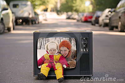 Mother and baby are in old television set