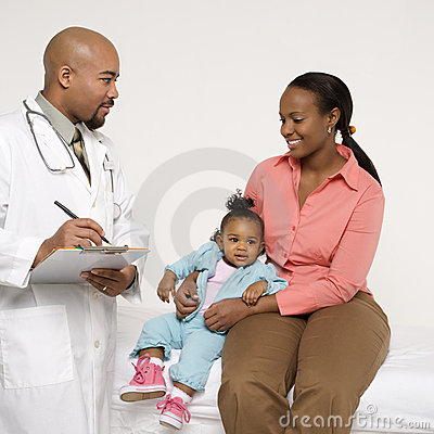 Mother and baby with pediatrician.